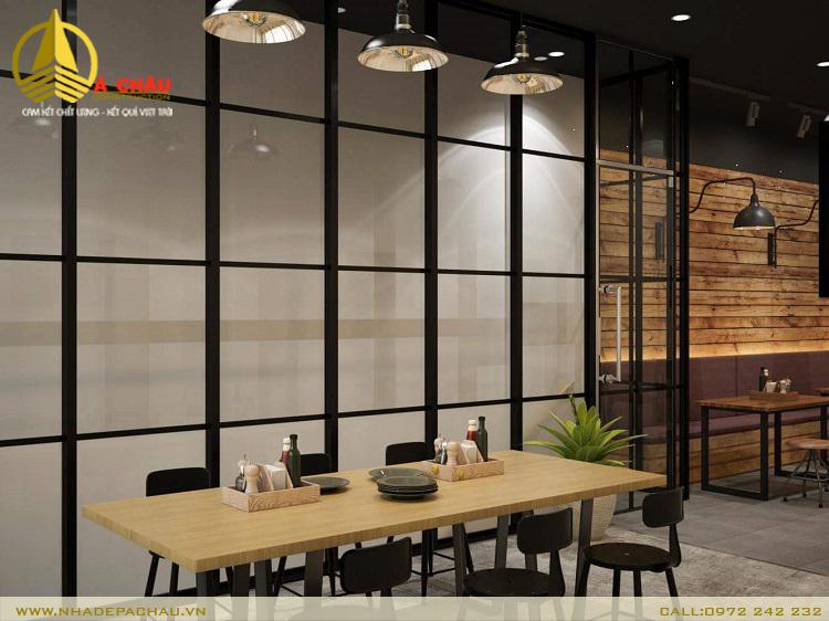 nhà hàng phở nổi bật với mảng ô cửa sổ sơn đen